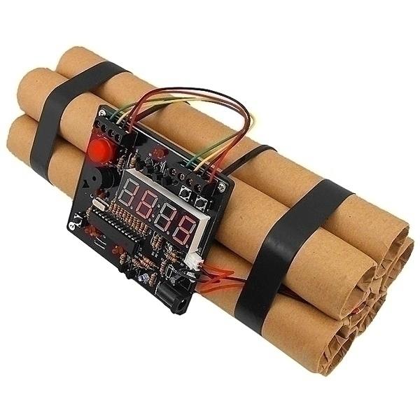 Часы - будильник Динамит. 9492094920Уникальная дизайнерская задумка выполнить будильник в виде смотки нескольких динамитных шашек с таймером. Будильник работает в трех режимах. В первом режиме - режиме будильника. Нужно установить будильник, удерживая левую кнопку, и при срабатывания будильника нужно в течение 10 секунд разминировать бомбу, для чего выбрать один из четырех цветных проводов, иначе проснутся все соседи. Второй режим – режим часов. Третий режим – это игра. Нажмите на красную кнопку и начнется 10-секундный отчет, в течение которого необходимо разминировать динамит. Будильник работает от встроенного аккумулятора и заряжается от USB в течение 8-ми часов.