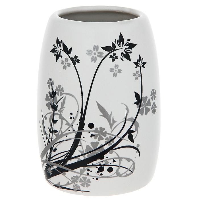 Стаканчик для ванной комнаты Duschy Aster354-01Стаканчик Duschy Aster выполнен из керамики молочного цвета, украшен растительным рисунком черного и серого цвета. Стаканчик отличается легкостью и компактностью, при этом он устойчив. Такой стаканчик прекрасно подойдет для зубных щеток, пасты, расчесок и станет достойным дополнением интерьера ванной комнаты.