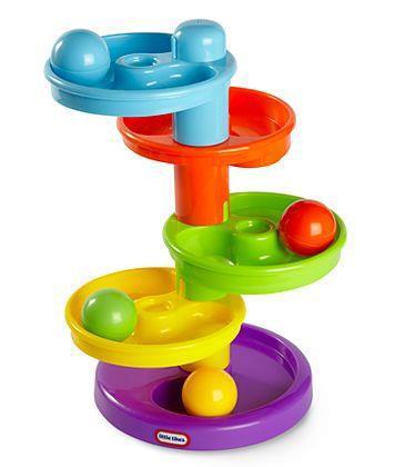Развивающая игрушка Горка-спираль635007Развивающая игрушка Горка-спираль - первый шаг ребенка в мир конструирования объемных лабиринтов. C помощью конструктора можно построить простой лабиринт, по которому будут кататься шарики. В комплекте детали: воронки для построения горки-спирали, 4 цветных шарика. Шарики – главные персонажи игры. Ребенок запускает шарик и с интересом следит как он движется по дорожкам, проходит лабиринт и выскакивает наружу. Такое наблюдение - занятие завораживающее, игрушка надолго привлечет внимание ребенка. Яркие цвета и форма игрушки направлены на развитие мыслительной деятельности, цветовосприятия, тактильных ощущений и мелкой моторики рук ребенка. Характеристики: Размер игрушки: 16 см х 9 см х 23 см. Диаметр шариков: 4,5 см. Рекомендуемый возраст: от 12 месяцев.