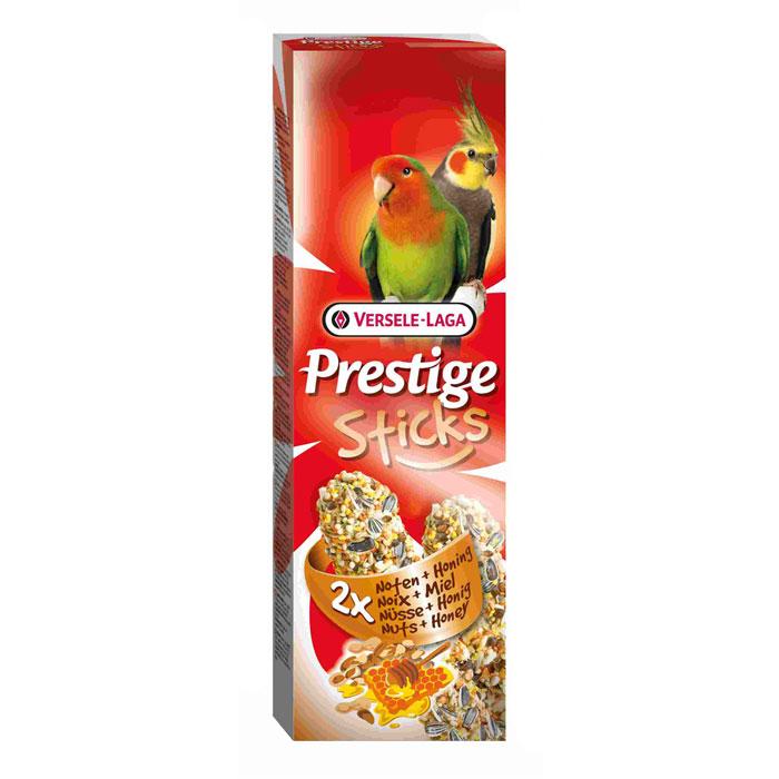 Лакомство Versele-Laga для средних попугаев, палочки с орехами и медом, 2х70 г422313Лакомство Versele-Laga представляет собой две запеченные палочки с арахисом, миндалем, медом и другими полезными ингредиентами для средних попугаев. Благодаря этому ореховому празднику ваша птица насладится кулинарными изысками. Для скуки не останется ни единого шанса. Состав: семена, зерновые, орехи (2,2%; земляной орех, миндаль), мед (2%), различные сахара, пекарские продукты, масла и жиры, консерванты, красители. Вес: 2 х 70 г. Товар сертифицирован.