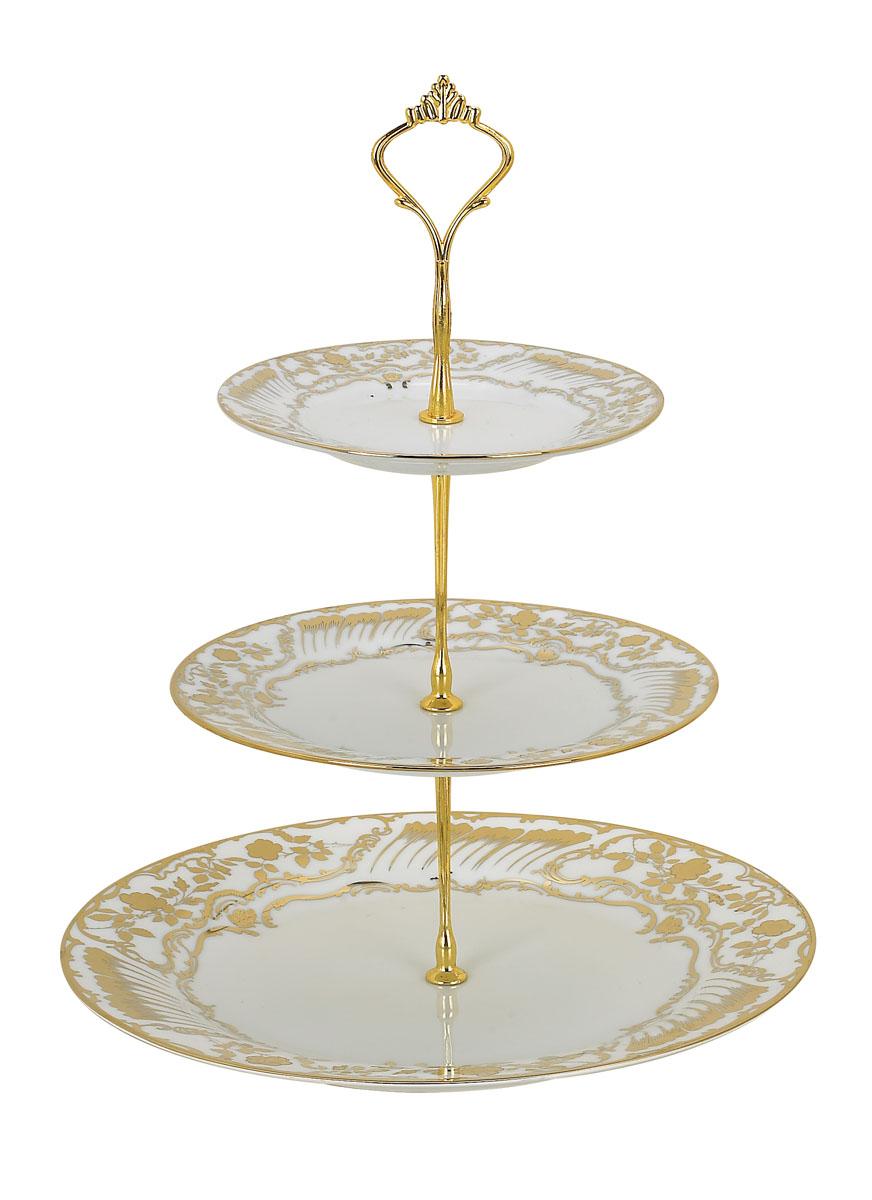 Ваза для фруктов Bekker BK-7500, 3 ярусаBK-7500Элегантная ваза Bekker, выполненная из фарфора, сочетает в себе изысканный дизайн с максимальной функциональностью. Ваза предназначена для красивой сервировки фруктов. Ярусы вазы оформлены красивым золотым узором. Держатель вазы выполнен из металла. Ваза для фруктов Bekker украсит сервировку вашего стола и подчеркнет прекрасный вкус хозяина, а также станет отличным подарком.