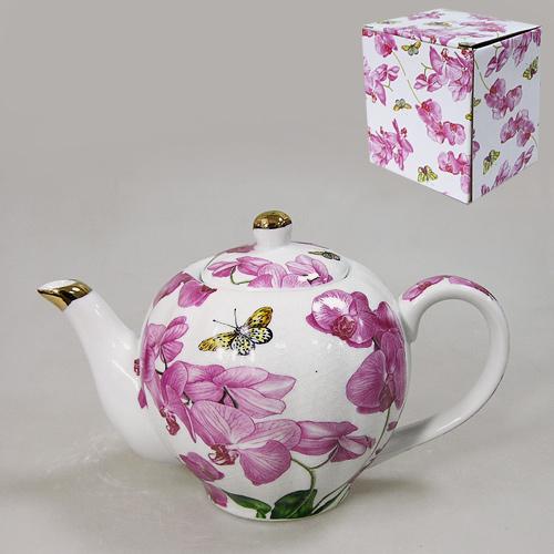 Чайник Орхидея, 900 мл545-223Чайник Орхидея выполнен из высококачественного фарфора светло-розового цвета и декорирован изображением цветков орхидеи. Красочность оформления придется по вкусу и ценителям классики, и тем, кто предпочитает утонченность и изящность. Чайник Орхидея украсит сервировку вашего стола и подчеркнет прекрасный вкус хозяина, а также станет отличным подарком. Чайник упакован картонную коробку. Размер чайника (с учетом носика, ручки и крышки): 21 х 12 х 14 см.