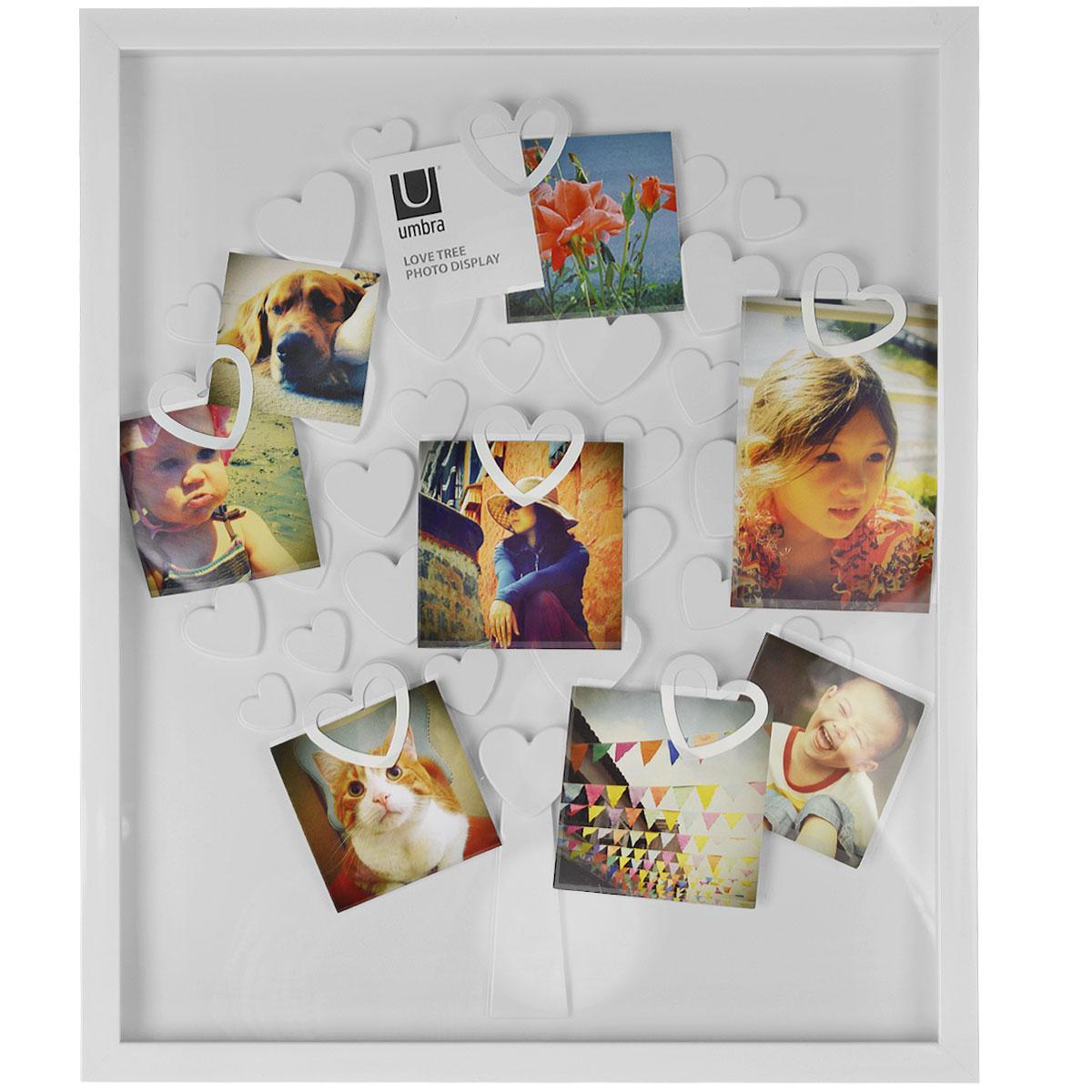 Рамка для фотографий Umbra Lovetree, настенная, цвет: белый. 311360-660311360-660Рамка для фотографий Umbra Lovetree выполнена из пластика в виде дерева. Лепестки-сердечки имеют специальные крепления, которые надежно держат до 30 фотографии. Дерево помещено в прямоугольную раму за стеклом. Такая рамка не только позволит сохранить на память изображения дорогих вам людей и интересных событий вашей жизни, но и стильно украсит интерьер помещения.