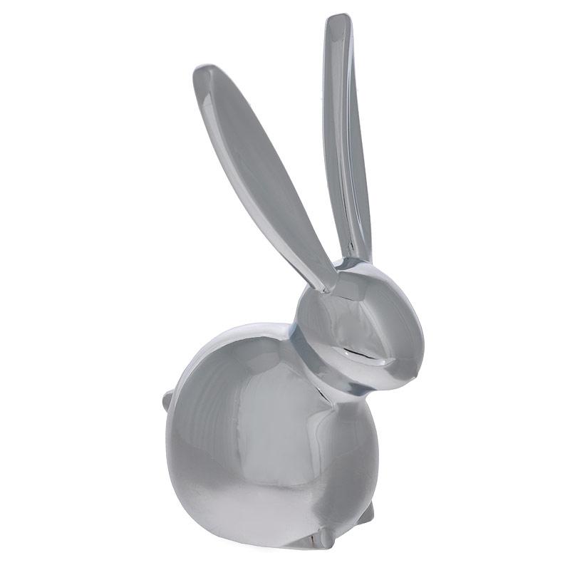 Подставка для колец Zoola Кролик299213-158Оригинальная подставка для колец Кролик выполнена из металла с зеркальной полировкой. Подставка-держатель выполнена в виде кролика, на ушки которого нанизываются кольца. Подставка для колец Кролик благодаря своей практичности и необычности станет не только идеальным подарком представительнице прекрасного пола, но и изысканным украшением интерьера. Характеристики: Материал: металл. Размер подставки: 3,5 см х 7 см х 3 см. Цвет: хром. Артикул: 299213-158.