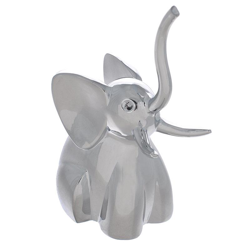 """Подставка для колец Zoola Слон299224-158Оригинальная подставка для колец """"Слон"""" выполнена из металла с зеркальной полировкой. Подставка-держатель выполнена в виде слоника, на хобот и бивни которого нанизываются кольца. Подставка для колец Слон благодаря своей практичности и необычности станет не только идеальным подарком представительнице прекрасного пола, но и изысканным украшением интерьера."""