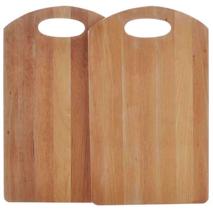 Набор разделочных досок Dormann, 2 шт9130/2Набор Dormann состоит из двух прямоугольных разделочных досок, изготовленных из темного дерева. Доски отличаются долговечностью, большой прочностью и высокой плотностью, легко моются, не впитывают запахи и обладают водоотталкивающими свойствами, при длительном использовании не деформируются. Набор прекрасно подойдет для приготовления и сервировки пищи. Немецкая фирма Dormann основана в 1985 году. Компания производит большой ассортимент изделий из дерева. В их число входят подносы, наборы специй, перечницы, разделочные доски, держатели для бокалов и пивных кружек. Для изготовления этих товаров используются каучуковое дерево, сплав стали с хромом и стекло. Разнообразный интересный дизайн, удобство в использовании и прочность материалов, из которых изготовлена продукция, дают полное право называть продукцию Dormann эталоном качества! Характеристики: Материал: дерево. Размер разделочной доски: 25 см х 15 см х 1 см. Комплектация: 2 шт. ...