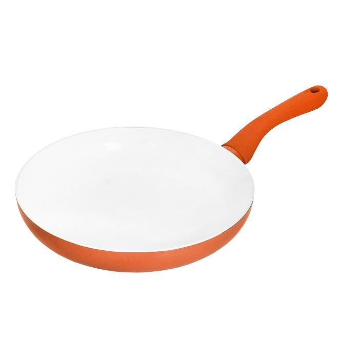 Сковорода Beka, с керамическим покрытием, цвет: оранжевый. Диаметр 26 см40067264Сковорода Beka изготовлена из алюминия с керамическим покрытием белого цвета. Эксклюзивное керамическое покрытие производится по особой технологии на водной основе без использования кислот. Данное покрытие является абсолютно экологичным и не содержит таких вредных веществ, как PTFE и PFOA. Это предотвращает их выделение в пищу даже в случае перегревания сковороды. Сковорода оснащена эргономичной ненагревающейся ручкой из пластика оранжевого цвета с покрытием soft-touch. Сковороду можно использовать на всех типах плит, кроме индукционных. Не рекомендуется мыть в посудомоечной машине. Не обрабатывайте сковороду абразивными моющими средствами.