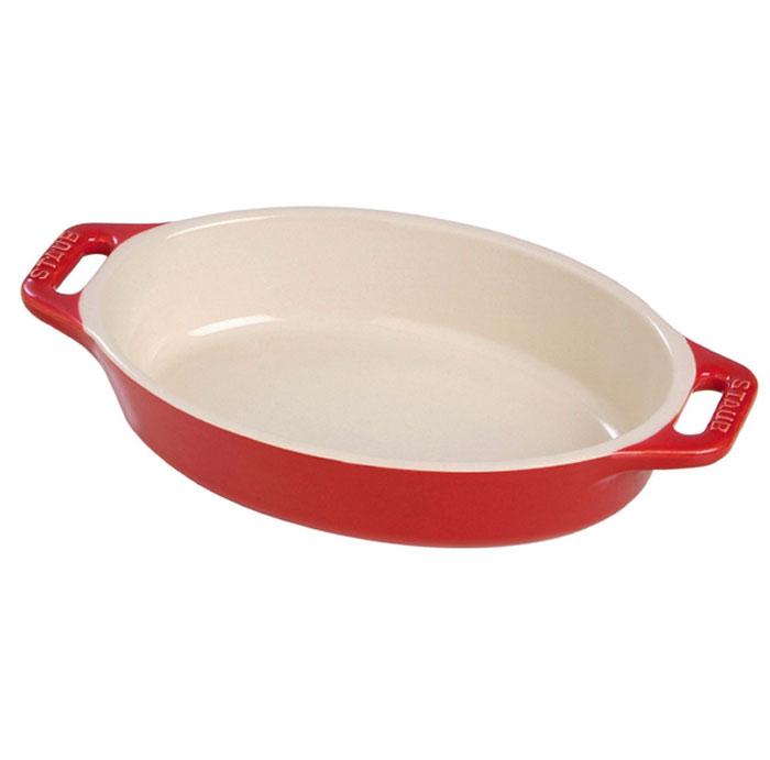 Форма овальная керамическая Staub, цвет: вишневый, 29 х 20 х 5,5 см40510-806Овальная форма Staub изготовлена из керамики, покрытой эмалью из стеклянного порошка. Не содержит свинца. Она отлично подойдет для приготовления и подачи на стол разнообразных запеканок, кексов и пирогов. Подходит для использования в духовке, гриле и микроволновой печи, может использоваться для сервировки. Нельзя использовать на открытом огне. Можно помещать в морозильную камеру, но не ставить керамическую посуду из морозильной камеры сразу в горячую духовку. Можно мыть в посудомоечной машине или вручную, используя губку. Сушить вверх дном. Максимальная и минимальная температура использования: +300°С/-20°С.