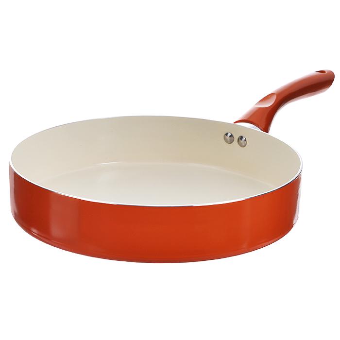 Сковорода Mayer & Boch, с керамическим покрытием, цвет: оранжевый. Диаметр 28 см. 2226322263 оранжевыйСковорода Mayer & Boch изготовлена из алюминия с высококачественным антипригарным керамическим покрытием. Керамика не содержит вредных примесей ПФОК, что способствует здоровому и экологичному приготовлению пищи. Кроме того, с таким покрытием пища не пригорает и не прилипает к стенкам, поэтому можно готовить с минимальным добавлением масла и жиров. Гладкая, идеально ровная поверхность сковороды легко чистится, ее можно мыть в воде руками или вытирать полотенцем. Эргономичная ручка специального дизайна выполнена из бакелита. Сковорода подходит для использования на газовых и электрических плитах. Также изделие можно мыть в посудомоечной машине. Диаметр: 28 см. Высота стенки: 6 см. Длина ручки: 18 см.