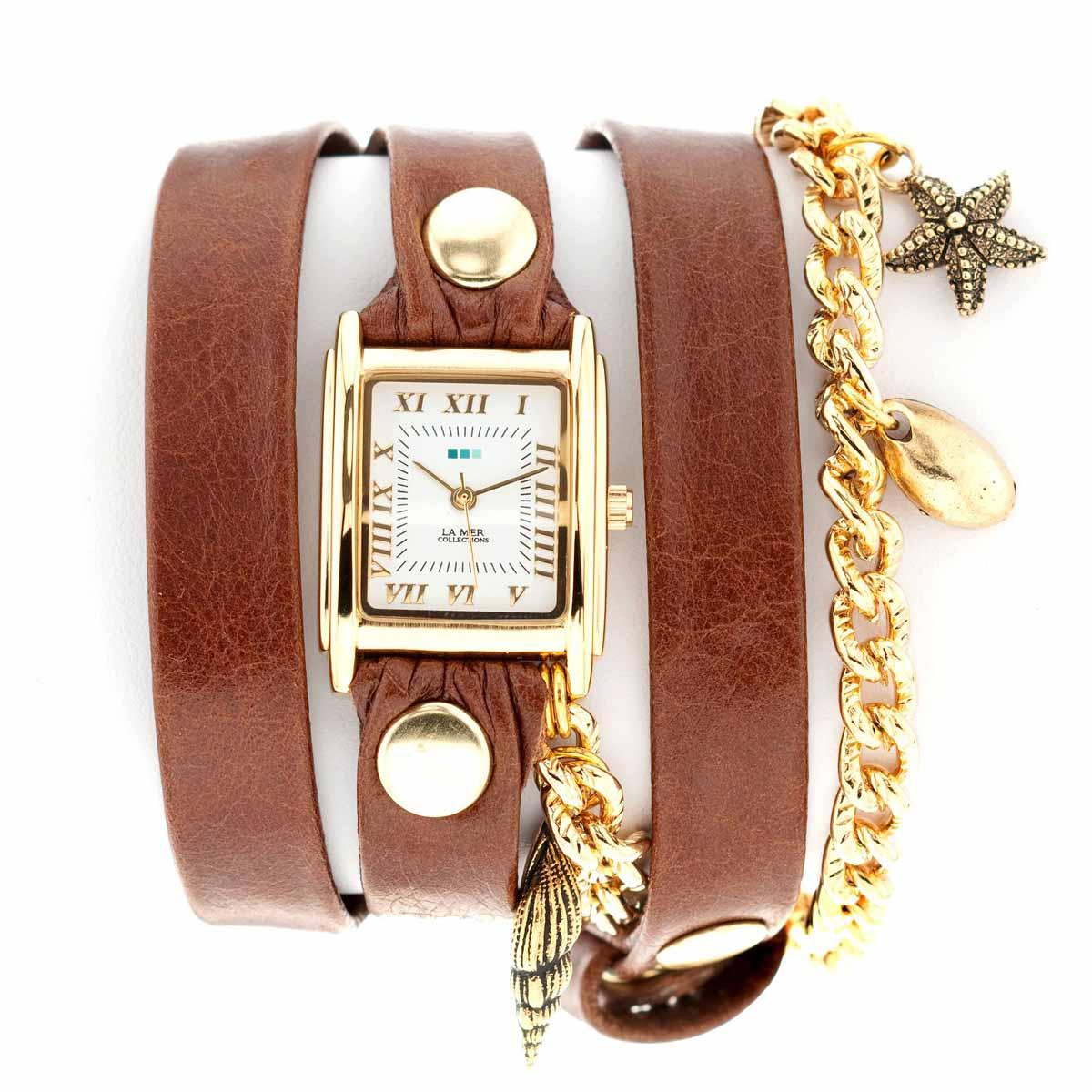 Часы женские наручные La Mer Collections Charm Seashells. LMCW4021xLMCW4021xЖенские наручные часы Charm Seashells позволят вам выделиться из толпы и подчеркнуть свою индивидуальность. Часы оснащены японским кварцевым механизмом SEIKO. Ремешок выполнен из натуральной итальянской кожи и оформлен позолоченной цепочкой, декорированной подвесками в виде ракушек. Корпус часов изготовлен из сплава металлов золотистого цвета. Циферблат оснащен часовой, минутной и секундной стрелками и защищен минеральным стеклом. Циферблат оформлен римскими цифрами и отметками. Часы застегиваются на классическую застежку. Часы хранятся на специальной подушечке в футляре из искусственной кожи, крышка которого оформлена логотипом компании La Mer Collection.