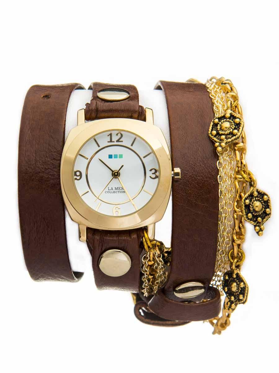 Часы наручные женские La Mer Collections Charm Gold Skull Tobacco. LMCW5002LMCW5002Часы оснащены японским кварцевым механизмом. Корпус круглой формы выполнен из нержавеющей стали золотистого цвета. Оригинальный кожаный ремешок коричневого цвета отделан металлическими клепками и дополнен цепочками. Каждая модель женских наручных часов La Mer Collections имеет эксклюзивный дизайн, в основу которого положено необычное сочетание классических циферблатов с удлиненными кожаными ремешками. Оборачиваясь вокруг запястья несколько раз, они образуют эффект кожаного браслета, превращая часы в женственный аксессуар, который великолепно дополнит другие аксессуары и весь образ в целом. Дизайн La Mer Collections отвечает всем последним тенденциям моды и превосходно сочетается с модными сумками, ремнями, обувью и другими элементами гардероба современных девушек. Часы La Mer - это еще и отличный подарок любимой девушке, сестре или подруге на день рождения, восьмое марта или новый год!