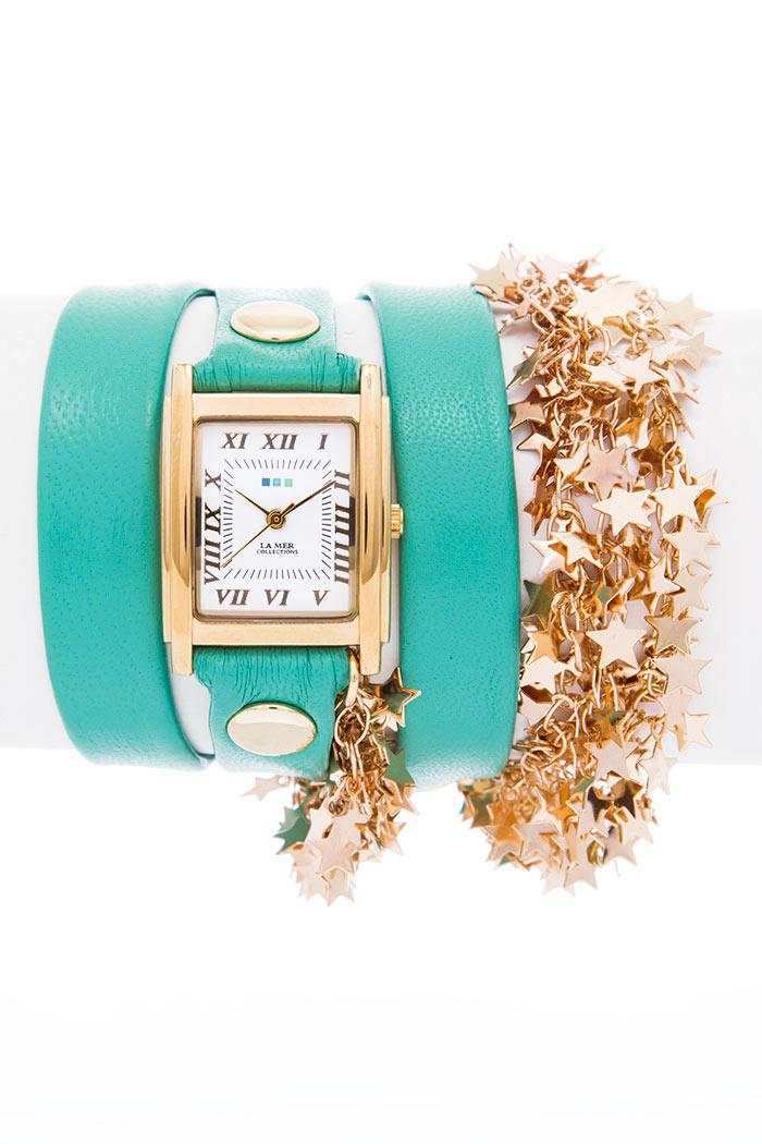 Часы наручные женские La Mer Collections Sparkling Stars Mint - Gold. LMCW6004LMCW6004Часы оснащены японским кварцевым механизмом. Корпус прямоугольной формы выполнен из нержавеющей стали золотистого цвета. Оригинальный ремешок бирюзового цвета отделан металлическими клепками и дополнен связкой цепочек со звездочками. Каждая модель женских наручных часов La Mer Collections имеет эксклюзивный дизайн, в основу которого положено необычное сочетание классических циферблатов с удлиненными кожаными ремешками. Оборачиваясь вокруг запястья несколько раз, они образуют эффект кожаного браслета, превращая часы в женственный аксессуар, который великолепно дополнит другие аксессуары и весь образ в целом. Дизайн La Mer Collections отвечает всем последним тенденциям моды и превосходно сочетается с модными сумками, ремнями, обувью и другими элементами гардероба современных девушек. Часы La Mer - это еще и отличный подарок любимой девушке, сестре или подруге на день рождения, восьмое марта или новый год!