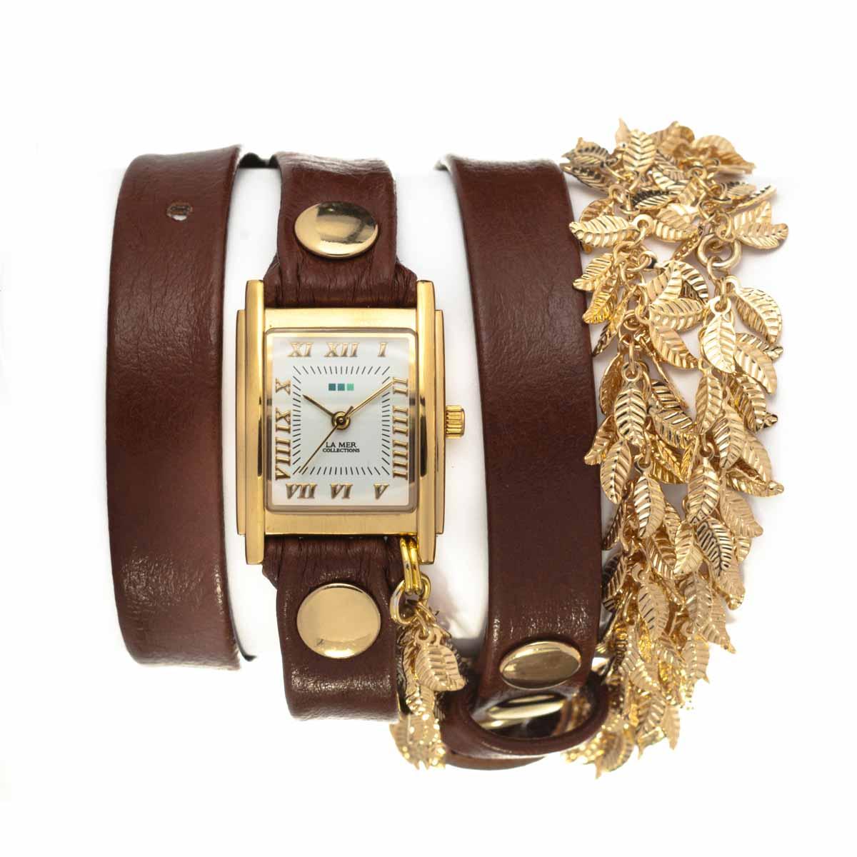 Часы наручные женские La Mer Collections Chain Multi Leaf Gold Brown. LMCW9002LMCW9002Часы оснащены японским кварцевым механизмом. Корпус прямоугольной формы выполнен из нержавеющей стали золотистого цвета. Оригинальный кожаный ремешок коричневого цвета отделан металлическими клепками и дополнен металлическими листьями. Каждая модель женских наручных часов La Mer Collections имеет эксклюзивный дизайн, в основу которого положено необычное сочетание классических циферблатов с удлиненными кожаными ремешками. Оборачиваясь вокруг запястья несколько раз, они образуют эффект кожаного браслета, превращая часы в женственный аксессуар, который великолепно дополнит другие аксессуары и весь образ в целом. Дизайн La Mer Collections отвечает всем последним тенденциям моды и превосходно сочетается с модными сумками, ремнями, обувью и другими элементами гардероба современных девушек. Часы La Mer - это еще и отличный подарок любимой девушке, сестре или подруге на день рождения, восьмое марта или новый год!