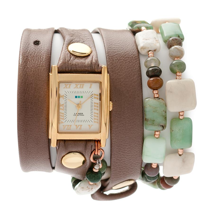 Часы наручные женские La Mer Collections Stones Amazonite Mushroom. LMMULTI1007LMMULTI1007Часы оснащены японским кварцевым механизмом. Корпус прямоугольной формы выполнен из нержавеющей стали золотистого цвета. Оригинальный кожаный ремешок коричневого цвета отделан металлическими клепками и дополнен декоративными камнями. Каждая модель женских наручных часов La Mer Collections имеет эксклюзивный дизайн, в основу которого положено необычное сочетание классических циферблатов с удлиненными кожаными ремешками. Оборачиваясь вокруг запястья несколько раз, они образуют эффект кожаного браслета, превращая часы в женственный аксессуар, который великолепно дополнит другие аксессуары и весь образ в целом. Дизайн La Mer Collections отвечает всем последним тенденциям моды и превосходно сочетается с модными сумками, ремнями, обувью и другими элементами гардероба современных девушек. Часы La Mer - это еще и отличный подарок любимой девушке, сестре или подруге на день рождения, восьмое марта или новый год!