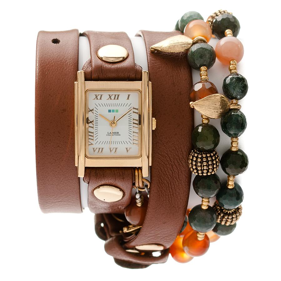 Часы наручные женские La Mer Collections Charm Thai Cognac. LMMULTI2006LMMULTI2006Часы оснащены японским кварцевым механизмом. Корпус прямоугольной формы выполнен из нержавеющей стали золотистого цвета. Оригинальный кожаный ремешок коричневого цвета отделан металлическими клепками и дополнен декоративными камнями. Каждая модель женских наручных часов La Mer Collections имеет эксклюзивный дизайн, в основу которого положено необычное сочетание классических циферблатов с удлиненными кожаными ремешками. Оборачиваясь вокруг запястья несколько раз, они образуют эффект кожаного браслета, превращая часы в женственный аксессуар, который великолепно дополнит другие аксессуары и весь образ в целом. Дизайн La Mer Collections отвечает всем последним тенденциям моды и превосходно сочетается с модными сумками, ремнями, обувью и другими элементами гардероба современных девушек. Часы La Mer - это еще и отличный подарок любимой девушке, сестре или подруге на день рождения, восьмое марта или новый год!