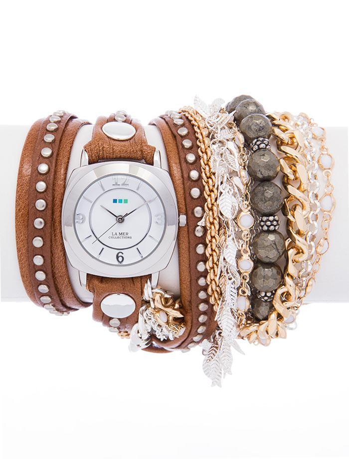 Часы женские наручные La Mer Collections Stones Parisian. LMMULTI2012LMMULTI2012Женские наручные часы Stones Parisian позволят вам выделиться из толпы и подчеркнуть свою индивидуальность. Часы оснащены японским кварцевым механизмом SEIKO. Ремешок состоит из двух слоев и выполнен из натуральной итальянской кожи с матовой поверхностью. Верхний слой декорирован заклепками. Ремешок также оформлен браслетом, состоящим из цепочек и бусин, украшенный пиритами. Корпус часов изготовлен из сплава металлов серебристого цвета. Циферблат круглой формы оснащен часовой, минутной и секундной стрелками и защищен минеральным стеклом. Циферблат оформлен арабскими цифрами и отметками. Часы застегиваются на классическую застежку. Часы хранятся на специальной подушечке в футляре из искусственной кожи, крышка которого оформлена логотипом компании La Mer Collection.