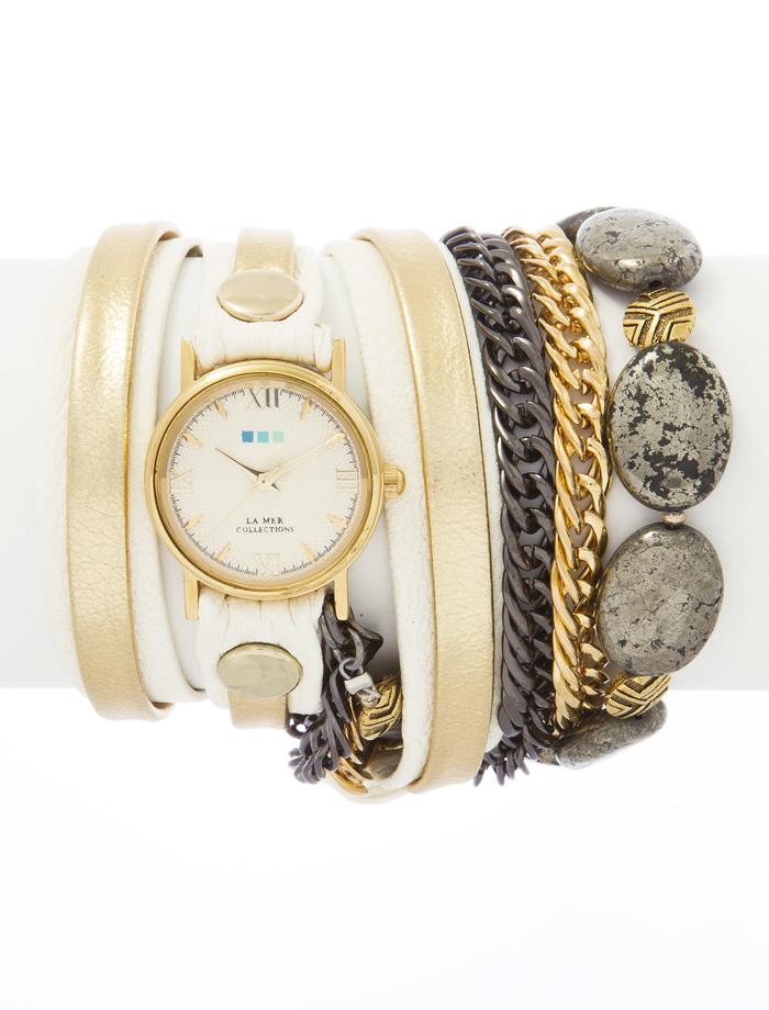 Часы наручные женские La Mer Collections Stones Kenyan Cream. LMMULTI7009LMMULTI7009Часы оснащены японским кварцевым механизмом. Корпус круглой формы выполнен из нержавеющей стали золотистого цвета. Оригинальный кожаный ремешок молочного цвета отделан металлическими клепками и дополнен связкой цепочек и декоративными камнями. Каждая модель женских наручных часов La Mer Collections имеет эксклюзивный дизайн, в основу которого положено необычное сочетание классических циферблатов с удлиненными кожаными ремешками. Оборачиваясь вокруг запястья несколько раз, они образуют эффект кожаного браслета, превращая часы в женственный аксессуар, который великолепно дополнит другие аксессуары и весь образ в целом. Дизайн La Mer Collections отвечает всем последним тенденциям моды и превосходно сочетается с модными сумками, ремнями, обувью и другими элементами гардероба современных девушек. Часы La Mer - это еще и отличный подарок любимой девушке, сестре или подруге на день рождения, восьмое марта или новый год!