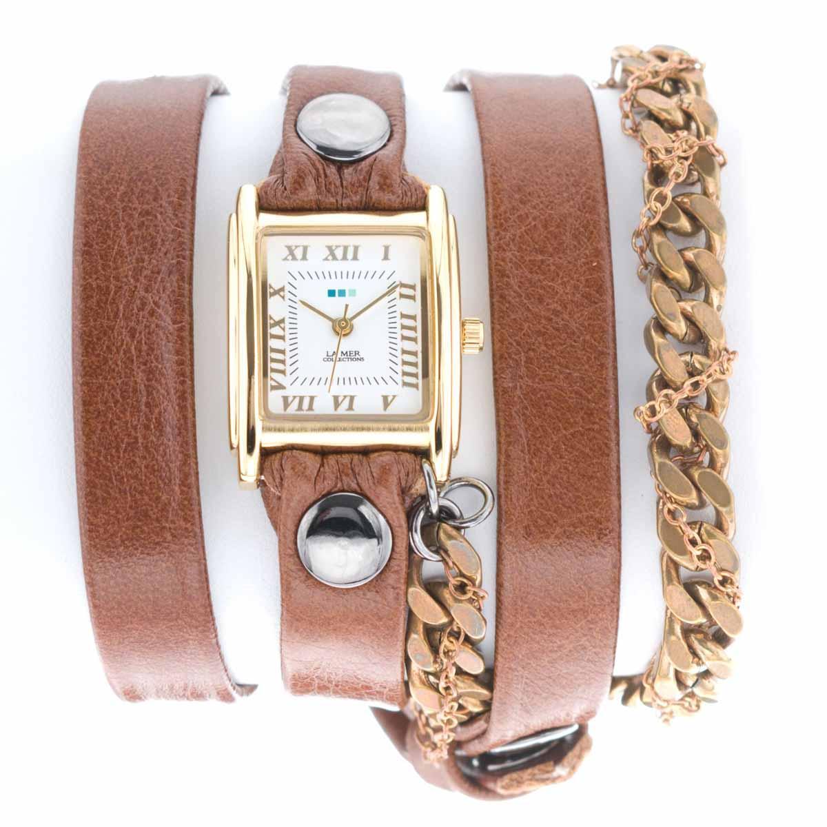 Часы наручные женские La Mer Collections Chain Moscow Braided Brown. LMMULTI8008xLMMULTI8008xЧасы оснащены японским кварцевым механизмом. Корпус прямоугольной формы выполнен из нержавеющей стали золотистого цвета. Оригинальный кожаный ремешок коричневого цвета отделан металлическими клепками и дополнен связкой цепочек. Каждая модель женских наручных часов La Mer Collections имеет эксклюзивный дизайн, в основу которого положено необычное сочетание классических циферблатов с удлиненными кожаными ремешками. Оборачиваясь вокруг запястья несколько раз, они образуют эффект кожаного браслета, превращая часы в женственный аксессуар, который великолепно дополнит другие аксессуары и весь образ в целом. Дизайн La Mer Collections отвечает всем последним тенденциям моды и превосходно сочетается с модными сумками, ремнями, обувью и другими элементами гардероба современных девушек. Часы La Mer - это еще и отличный подарок любимой девушке, сестре или подруге на день рождения, восьмое марта или новый год!