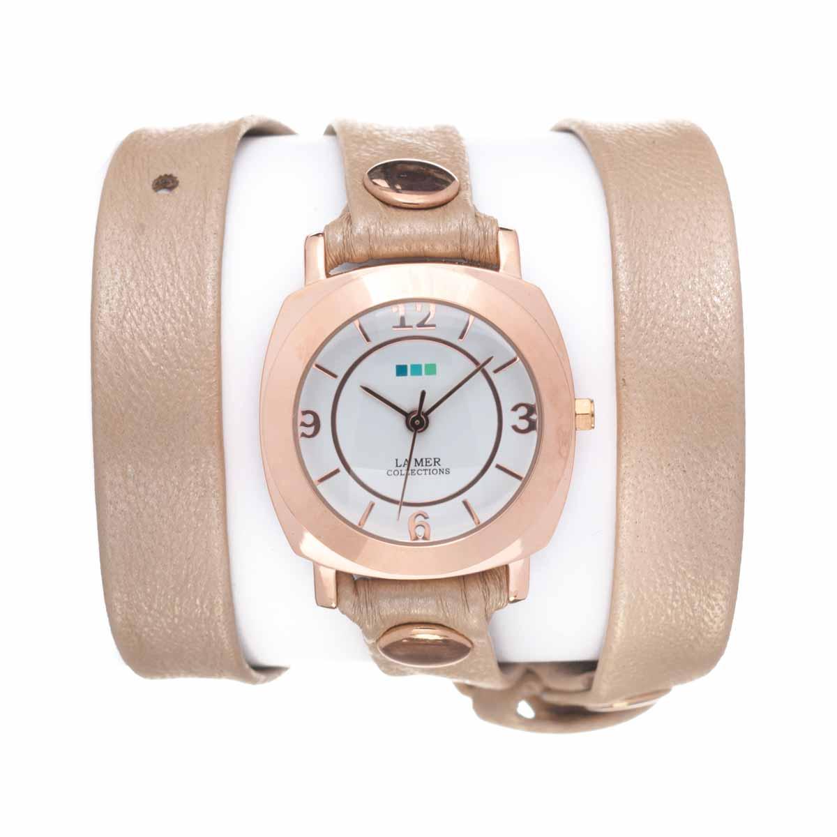 Часы наручные женские La Mer Collections Odyssey Pearl Rose Gold. LMODY3001xLMODY3001xЧасы оснащены японским кварцевым механизмом. Корпус круглой формы выполнен из нержавеющей стали золотистого цвета. Оригинальный кожаный ремешок бежевого цвета отделан металлическими клепками. Каждая модель женских наручных часов La Mer Collections имеет эксклюзивный дизайн, в основу которого положено необычное сочетание классических циферблатов с удлиненными кожаными ремешками. Оборачиваясь вокруг запястья несколько раз, они образуют эффект кожаного браслета, превращая часы в женственный аксессуар, который великолепно дополнит другие аксессуары и весь образ в целом. Дизайн La Mer Collections отвечает всем последним тенденциям моды и превосходно сочетается с модными сумками, ремнями, обувью и другими элементами гардероба современных девушек. Часы La Mer - это еще и отличный подарок любимой девушке, сестре или подруге на день рождения, восьмое марта или новый год!