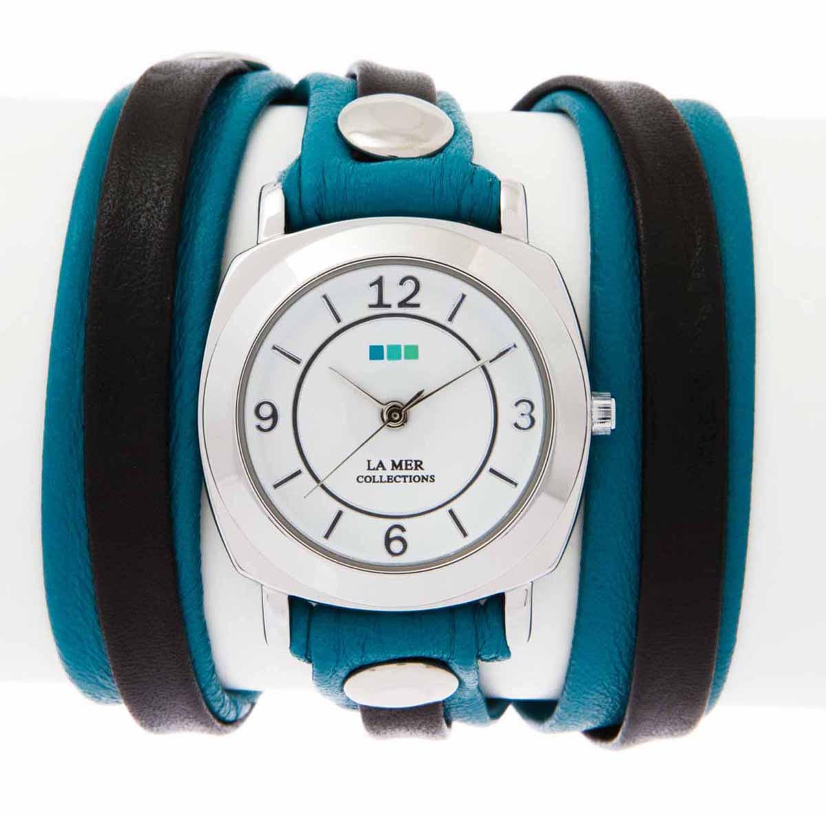 Часы наручные женские La Mer Collections Layer Odyssey Aqua Blackd. LMODYLY004LMODYLY004Часы оснащены японским кварцевым механизмом. Корпус круглой формы выполнен из нержавеющей стали серебристого цвета. Оригинальный кожаный ремешок черного и зеленого цветов отделан металлическими клепками. Каждая модель женских наручных часов La Mer Collections имеет эксклюзивный дизайн, в основу которого положено необычное сочетание классических циферблатов с удлиненными кожаными ремешками. Оборачиваясь вокруг запястья несколько раз, они образуют эффект кожаного браслета, превращая часы в женственный аксессуар, который великолепно дополнит другие аксессуары и весь образ в целом. Дизайн La Mer Collections отвечает всем последним тенденциям моды и превосходно сочетается с модными сумками, ремнями, обувью и другими элементами гардероба современных девушек. Часы La Mer - это еще и отличный подарок любимой девушке, сестре или подруге на день рождения, восьмое марта или новый год! Характеристики: Механизм: кварцевый SEIKO (Япония). Размер корпуса: 29...