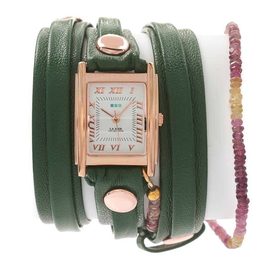 Часы наручные женские La Mer Collections Stones Rainbow Tourmaline Emerald. LMPREC001LMPREC001Часы оснащены японским кварцевым механизмом. Корпус прямоугольной формы выполнен из нержавеющей стали золотистого цвета. Оригинальный кожаный ремешок зеленого цвета отделан металлическими клепками и дополнен декоративными камнями. Каждая модель женских наручных часов La Mer Collections имеет эксклюзивный дизайн, в основу которого положено необычное сочетание классических циферблатов с удлиненными кожаными ремешками. Оборачиваясь вокруг запястья несколько раз, они образуют эффект кожаного браслета, превращая часы в женственный аксессуар, который великолепно дополнит другие аксессуары и весь образ в целом. Дизайн La Mer Collections отвечает всем последним тенденциям моды и превосходно сочетается с модными сумками, ремнями, обувью и другими элементами гардероба современных девушек. Часы La Mer - это еще и отличный подарок любимой девушке, сестре или подруге на день рождения, восьмое марта или новый год!