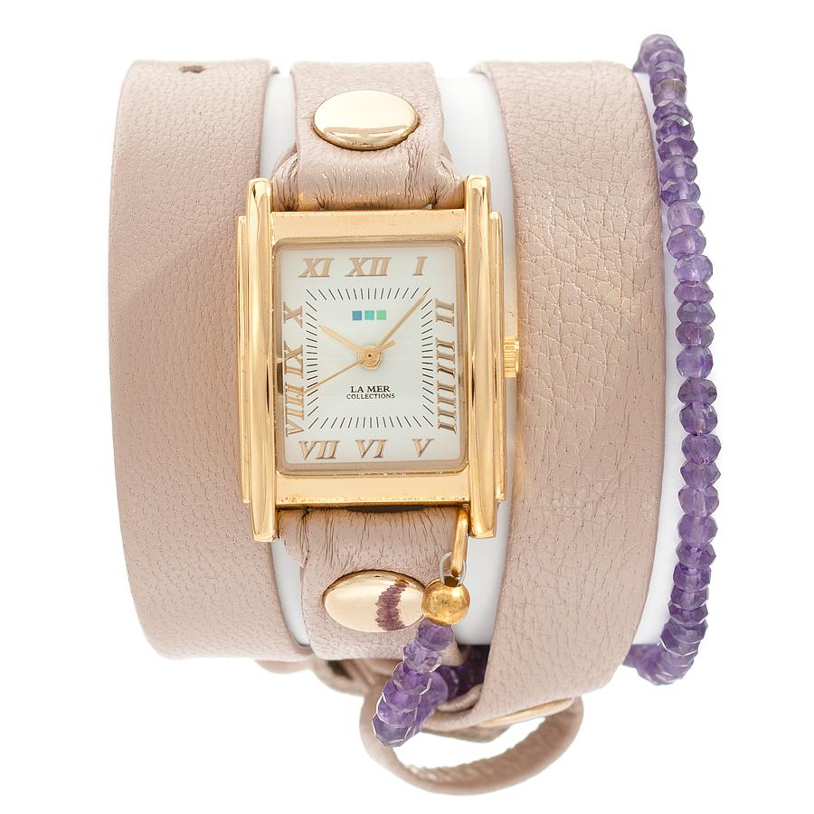 Часы наручные женские La Mer Collections Stones Amethyst Nude Gold. LMPREC004LMPREC004Часы оснащены японским кварцевым механизмом. Корпус прямоугольной формы выполнен из нержавеющей стали золотистого цвета. Оригинальный кожаный ремешок бежевого цвета отделан металлическими клепками и дополнен декоративными камнями. Каждая модель женских наручных часов La Mer Collections имеет эксклюзивный дизайн, в основу которого положено необычное сочетание классических циферблатов с удлиненными кожаными ремешками. Оборачиваясь вокруг запястья несколько раз, они образуют эффект кожаного браслета, превращая часы в женственный аксессуар, который великолепно дополнит другие аксессуары и весь образ в целом. Дизайн La Mer Collections отвечает всем последним тенденциям моды и превосходно сочетается с модными сумками, ремнями, обувью и другими элементами гардероба современных девушек. Часы La Mer - это еще и отличный подарок любимой девушке, сестре или подруге на день рождения, восьмое марта или новый год!