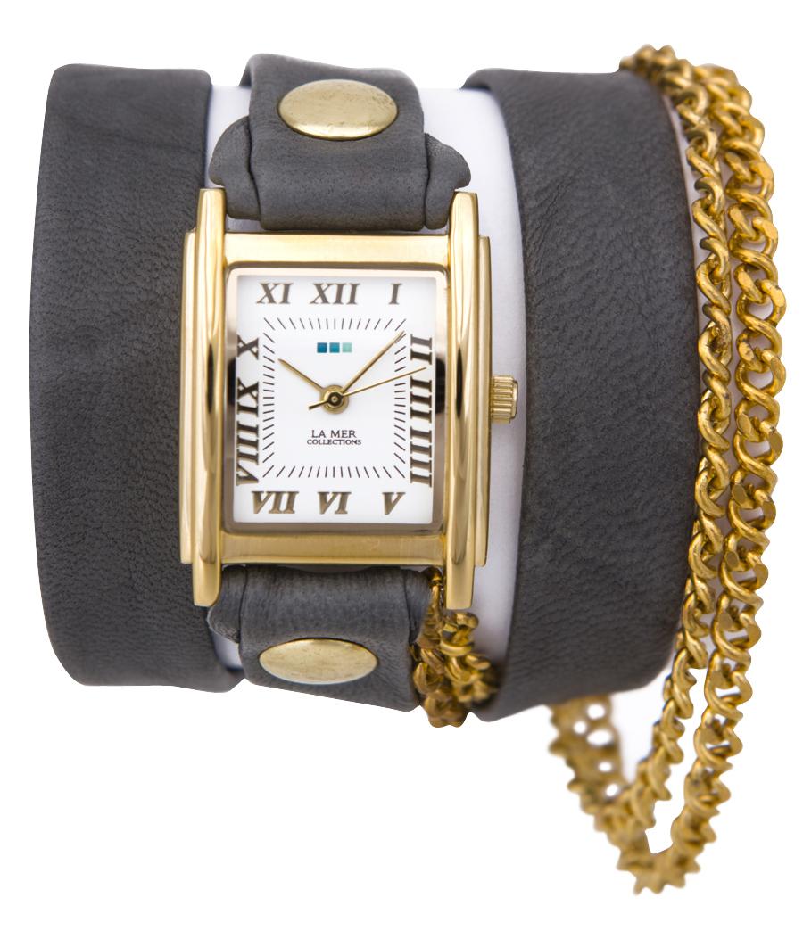 Часы наручные женские La Mer Collections Chain Vintage Grey Gold. LMSCW1004xLMSCW1004xЧасы оснащены японским кварцевым механизмом. Корпус прямоугольной формы выполнен из нержавеющей стали золотистого цвета. Оригинальный кожаный ремешок серого цвета отделан металлическими клепками и дополнен цепочкой. Каждая модель женских наручных часов La Mer Collections имеет эксклюзивный дизайн, в основу которого положено необычное сочетание классических циферблатов с удлиненными кожаными ремешками. Оборачиваясь вокруг запястья несколько раз, они образуют эффект кожаного браслета, превращая часы в женственный аксессуар, который великолепно дополнит другие аксессуары и весь образ в целом. Дизайн La Mer Collections отвечает всем последним тенденциям моды и превосходно сочетается с модными сумками, ремнями, обувью и другими элементами гардероба современных девушек. Часы La Mer - это еще и отличный подарок любимой девушке, сестре или подруге на день рождения, восьмое марта или новый год!