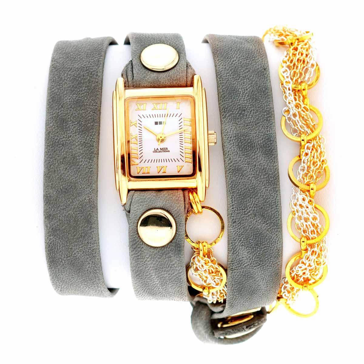 Часы наручные женские La Mer Collections Chain Volcanic Cement Gold. LMSCW6004BLMSCW6004BЧасы оснащены японским кварцевым механизмом. Корпус прямоугольной формы выполнен из нержавеющей стали золотистого цвета. Оригинальный кожаный ремешок серого цвета отделан металлическими клепками и дополнен связкой цепочек. Каждая модель женских наручных часов La Mer Collections имеет эксклюзивный дизайн, в основу которого положено необычное сочетание классических циферблатов с удлиненными кожаными ремешками. Оборачиваясь вокруг запястья несколько раз, они образуют эффект кожаного браслета, превращая часы в женственный аксессуар, который великолепно дополнит другие аксессуары и весь образ в целом. Дизайн La Mer Collections отвечает всем последним тенденциям моды и превосходно сочетается с модными сумками, ремнями, обувью и другими элементами гардероба современных девушек. Часы La Mer - это еще и отличный подарок любимой девушке, сестре или подруге на день рождения, восьмое марта или новый год!