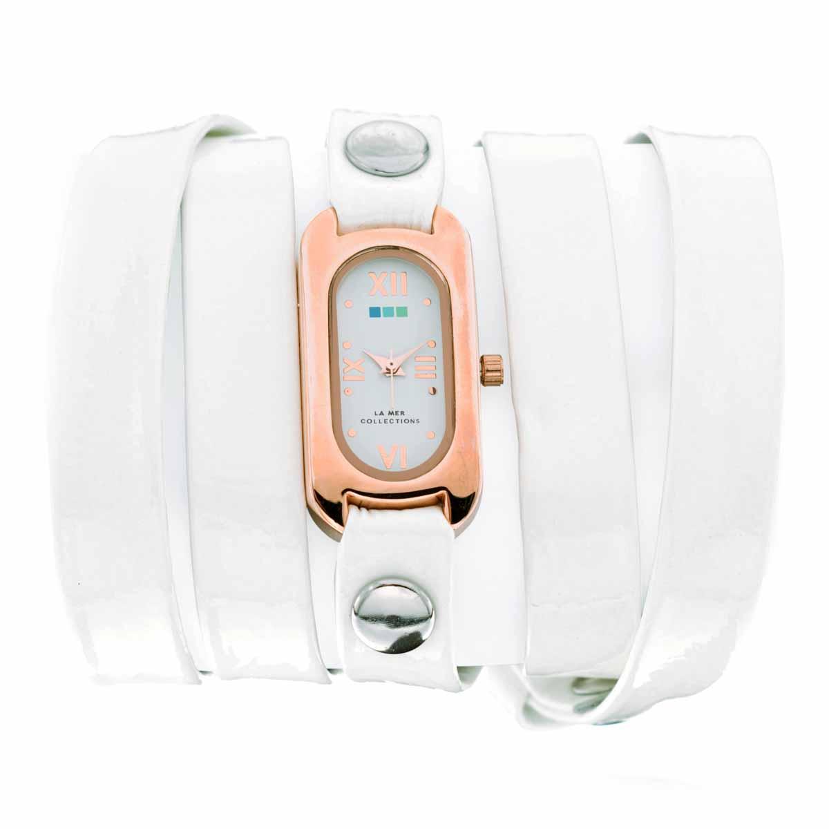 Часы наручные женские La Mer Collections Soho White Patent Rose Gold Case. LMSOHO1003 LakLMSOHO1003 LakЧасы оснащены японским кварцевым механизмом. Корпус прямоугольной формы выполнен из нержавеющей стали золотистого цвета. Оригинальный кожаный ремешок белого цвета отделан металлическими клепками. Каждая модель женских наручных часов La Mer Collections имеет эксклюзивный дизайн, в основу которого положено необычное сочетание классических циферблатов с удлиненными кожаными ремешками. Оборачиваясь вокруг запястья несколько раз, они образуют эффект кожаного браслета, превращая часы в женственный аксессуар, который великолепно дополнит другие аксессуары и весь образ в целом. Дизайн La Mer Collections отвечает всем последним тенденциям моды и превосходно сочетается с модными сумками, ремнями, обувью и другими элементами гардероба современных девушек. Часы La Mer - это еще и отличный подарок любимой девушке, сестре или подруге на день рождения, восьмое марта или новый год! Характеристики: Механизм: кварцевый SEIKO (Япония). Размер корпуса: 32 х 19 х...