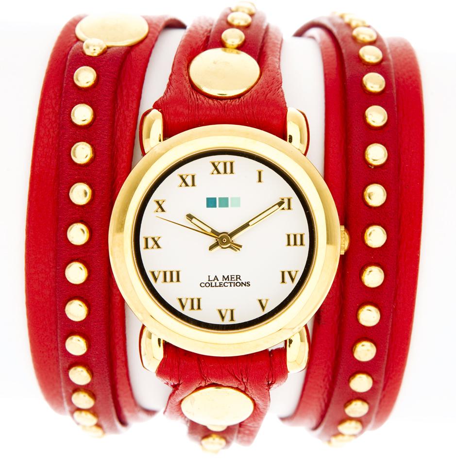 Часы наручные женские La Mer Collections Bali Red/Gold. LMSW3005xLMSW3005xЧасы оснащены японским кварцевым механизмом. Корпус круглой формы выполнен из нержавеющей стали золотистого цвета. Оригинальный кожаный ремешок красного цвета отделан металлическими клепками. Каждая модель женских наручных часов La Mer Collections имеет эксклюзивный дизайн, в основу которого положено необычное сочетание классических циферблатов с удлиненными кожаными ремешками. Оборачиваясь вокруг запястья несколько раз, они образуют эффект кожаного браслета, превращая часы в женственный аксессуар, который великолепно дополнит другие аксессуары и весь образ в целом. Дизайн La Mer Collections отвечает всем последним тенденциям моды и превосходно сочетается с модными сумками, ремнями, обувью и другими элементами гардероба современных девушек. Часы La Mer - это еще и отличный подарок любимой девушке, сестре или подруге на день рождения, восьмое марта или новый год!