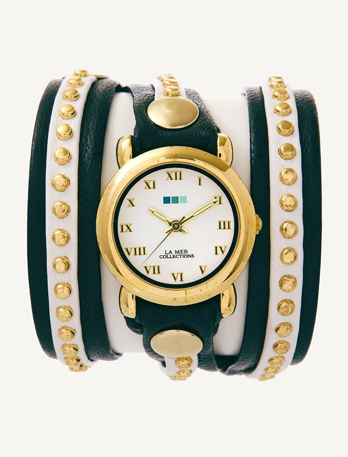 Часы наручные женские La Mer Collections Bali Navy/White/Gold. LMSW3013LMSW3013Часы оснащены японским кварцевым механизмом. Корпус круглой формы выполнен из нержавеющей стали золотистого цвета. Оригинальный кожаный ремешок синего и белого цветов отделан металлическими клепками. Каждая модель женских наручных часов La Mer Collections имеет эксклюзивный дизайн, в основу которого положено необычное сочетание классических циферблатов с удлиненными кожаными ремешками. Оборачиваясь вокруг запястья несколько раз, они образуют эффект кожаного браслета, превращая часы в женственный аксессуар, который великолепно дополнит другие аксессуары и весь образ в целом. Дизайн La Mer Collections отвечает всем последним тенденциям моды и превосходно сочетается с модными сумками, ремнями, обувью и другими элементами гардероба современных девушек. Часы La Mer - это еще и отличный подарок любимой девушке, сестре или подруге на день рождения, восьмое марта или новый год! Характеристики: Механизм: кварцевый SEIKO (Япония). Размер корпуса: 22 х...