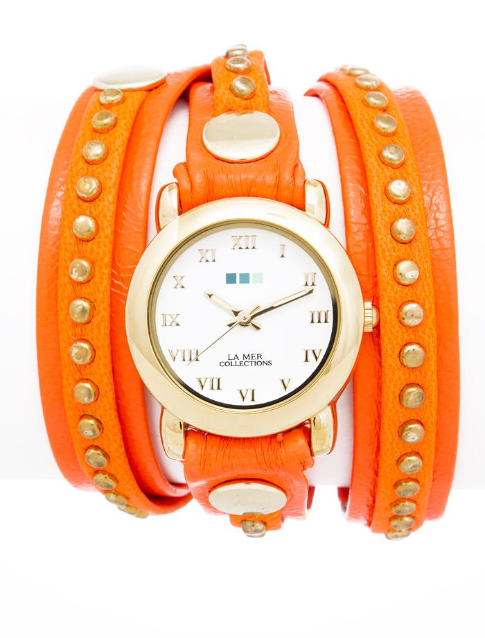 Часы женские наручные La Mer Collections Bali Neon Orange Gold. LMSW4001LMSW4001Женские наручные часы Bali Neon Orange Gold позволят вам выделиться из толпы и подчеркнуть свою индивидуальность. Часы оснащены японским кварцевым механизмом SEIKO. Ремешок выполнен из натуральной итальянской кожи с матовой поверхностью и состоит из двух слоев. Верхний слой декорирован металлическими заклепками. Корпус часов изготовлен из сплава металлов золотистого цвета. Циферблат оснащен часовой, минутной и секундной стрелками и защищен минеральным стеклом. Часовая и минутная стрелки светятся в темноте. Циферблат оформлен римскими цифрами. Часы застегиваются на классическую застежку. Часы хранятся на специальной подушечке в футляре из искусственной кожи, крышка которого оформлена логотипом компании La Mer Collection.