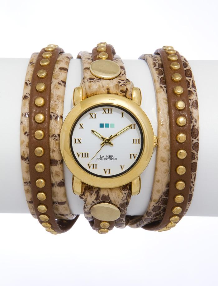 Часы наручные женские La Mer Collections Bali Creme Brown Snake/Tan Gold. LMSW6004LMSW6004Часы оснащены японским кварцевым механизмом. Корпус круглой формы выполнен из нержавеющей стали золотистого цвета. Оригинальный кожаный ремешок коричневого цвета с тиснением под рептилию отделан металлическими клепками. Каждая модель женских наручных часов La Mer Collections имеет эксклюзивный дизайн, в основу которого положено необычное сочетание классических циферблатов с удлиненными кожаными ремешками. Оборачиваясь вокруг запястья несколько раз, они образуют эффект кожаного браслета, превращая часы в женственный аксессуар, который великолепно дополнит другие аксессуары и весь образ в целом. Дизайн La Mer Collections отвечает всем последним тенденциям моды и превосходно сочетается с модными сумками, ремнями, обувью и другими элементами гардероба современных девушек. Часы La Mer - это еще и отличный подарок любимой девушке, сестре или подруге на день рождения, восьмое марта или новый год!