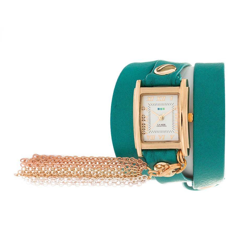 Часы наручные женские La Mer Collections Rainbow Tassle Dark Aqua Gold. LMTASSLE001ALMTASSLE001AЧасы оснащены японским кварцевым механизмом. Корпус прямоугольной формы выполнен из нержавеющей стали золотистого цвета. Оригинальный кожаный ремешок бирюзового цвета отделан металлическими клепками. Каждая модель женских наручных часов La Mer Collections имеет эксклюзивный дизайн, в основу которого положено необычное сочетание классических циферблатов с удлиненными кожаными ремешками. Оборачиваясь вокруг запястья несколько раз, они образуют эффект кожаного браслета, превращая часы в женственный аксессуар, который великолепно дополнит другие аксессуары и весь образ в целом. Дизайн La Mer Collections отвечает всем последним тенденциям моды и превосходно сочетается с модными сумками, ремнями, обувью и другими элементами гардероба современных девушек. Часы La Mer - это еще и отличный подарок любимой девушке, сестре или подруге на день рождения, восьмое марта или новый год!