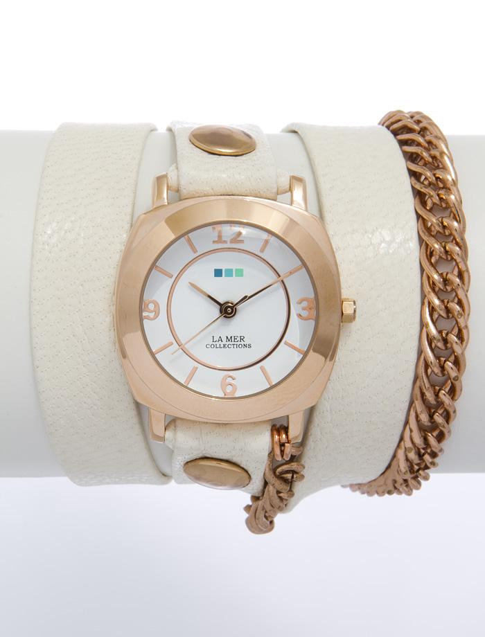 Часы наручные женские La Mer Collections Chain Glam Eggshell/Rose Gold. LMSCW3000xLMSCW3000xЧасы оснащены японским кварцевым механизмом. Корпус круглой формы выполнен из нержавеющей стали золотистого цвета. Оригинальный кожаный ремешок бежевого цвета отделан металлическими клепками и дополнен цепочкой. Каждая модель женских наручных часов La Mer Collections имеет эксклюзивный дизайн, в основу которого положено необычное сочетание классических циферблатов с удлиненными кожаными ремешками. Оборачиваясь вокруг запястья несколько раз, они образуют эффект кожаного браслета, превращая часы в женственный аксессуар, который великолепно дополнит другие аксессуары и весь образ в целом. Дизайн La Mer Collections отвечает всем последним тенденциям моды и превосходно сочетается с модными сумками, ремнями, обувью и другими элементами гардероба современных девушек. Часы La Mer - это еще и отличный подарок любимой девушке, сестре или подруге на день рождения, восьмое марта или новый год! Характеристики: Механизм: кварцевый SEIKO (Япония). Размер...