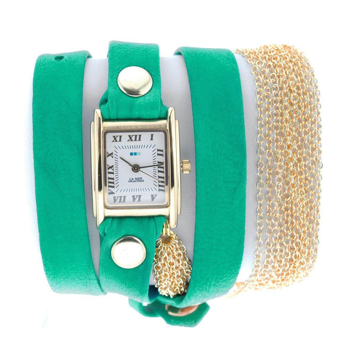 Часы наручные женские La Mer Collections Chain Rio Gold Teal. LMMULTICW1021TEALLMMULTICW1021TEALЧасы оснащены японским кварцевым механизмом. Корпус прямоугольной формы выполнен из нержавеющей стали золотистого цвета. Оригинальный кожаный ремешок зеленого цвета отделан металлическими клепками и дополнен связкой цепочек. Каждая модель женских наручных часов La Mer Collections имеет эксклюзивный дизайн, в основу которого положено необычное сочетание классических циферблатов с удлиненными кожаными ремешками. Оборачиваясь вокруг запястья несколько раз, они образуют эффект кожаного браслета, превращая часы в женственный аксессуар, который великолепно дополнит другие аксессуары и весь образ в целом. Дизайн La Mer Collections отвечает всем последним тенденциям моды и превосходно сочетается с модными сумками, ремнями, обувью и другими элементами гардероба современных девушек. Часы La Mer - это еще и отличный подарок любимой девушке, сестре или подруге на день рождения, восьмое марта или новый год!
