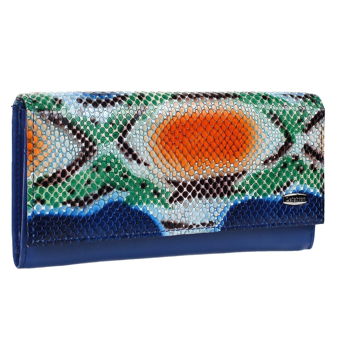 Кошелек женский Leighton, цвет: синий питон. 22161-15511/1583422161-15511/15834 син питКошелек Leighton выполнен из высококачественной натуральной кожи синего цвета с декоративным теснением под рептилию. Кошелек закрывается широким клапаном на кнопку. Имеет внутри отделение для купюр, шесть отделений под визитки и пластиковые карты, два кармашка с пластиковым окошком для фото и потайной карман на застежке-молнии. На внешней стороне задней стенки предусмотрено отделение для бумаг, а также карман для мелочи, закрывающийся на застежку-молнию. Имеет чехол для хранения. Классический дизайн и стильный декор в сочетании с удобством и вместительностью делают этот аксессуар незаменимым. Характеристики: Материал: натуральная кожа, металл, текстиль. Размер: 18 см х 9 см х 2,5 см. Цвет: синий.