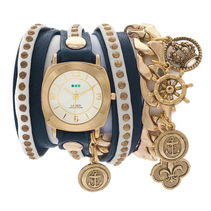 Часы наручные женские La Mer Collections Charm Nautical Navy White. LMCW2003LMCW2003Часы оснащены японским кварцевым механизмом. Корпус круглой формы выполнен из нержавеющей стали золотистого цвета. Оригинальный кожаный ремешок синего и белого цветов отделан металлическими клепками и дополнен цепочкой с декоративными элементами. Каждая модель женских наручных часов La Mer Collections имеет эксклюзивный дизайн, в основу которого положено необычное сочетание классических циферблатов с удлиненными кожаными ремешками. Оборачиваясь вокруг запястья несколько раз, они образуют эффект кожаного браслета, превращая часы в женственный аксессуар, который великолепно дополнит другие аксессуары и весь образ в целом. Дизайн La Mer Collections отвечает всем последним тенденциям моды и превосходно сочетается с модными сумками, ремнями, обувью и другими элементами гардероба современных девушек. Часы La Mer - это еще и отличный подарок любимой девушке, сестре или подруге на день рождения, восьмое марта или новый год!