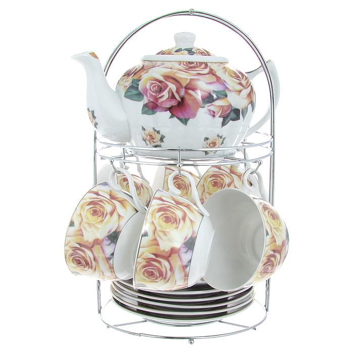 Набор чайный Lillo на подставке, 13 предметов. 213488213488Чайный набор Lillo состоит из шести чашек, шести блюдец и заварочного чайника. Предметы набора изготовлены из высококачественного фарфора и оформлены изображением роз. Все предметы располагаются на удобной металлической подставке с ручкой. Элегантный дизайн набора придется по вкусу и ценителям классики, и тем, кто предпочитает утонченность и изысканность. Он настроит на позитивный лад и подарит хорошее настроение с самого утра. Чайный набор Lillo идеально подойдет для сервировки стола и станет отличным подарком к любому празднику. Чайный набор упакован в красочную подарочную коробку из плотного картона.