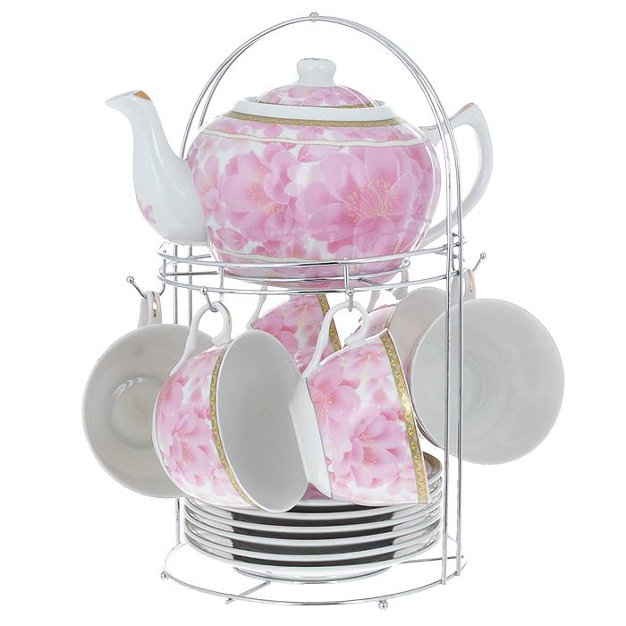 Набор чайный Lillo на подставке, 13 предметов. 213485213485Чайный набор Lillo состоит из шести чашек, шести блюдец и заварочного чайника. Предметы набора изготовлены из высококачественного фарфора и оформлены изображением розовых цветов. Все предметы располагаются на удобной металлической подставке с ручкой. Элегантный дизайн набора придется по вкусу и ценителям классики, и тем, кто предпочитает утонченность и изысканность. Он настроит на позитивный лад и подарит хорошее настроение с самого утра. Чайный набор Lillo идеально подойдет для сервировки стола и станет отличным подарком к любому празднику. Чайный набор упакован в красочную подарочную коробку из плотного картона. Характеристики: Материал: фарфор, металл. Объем чашки: 270 мл. Диаметр чашки по верхнему краю: 9,5 см. Высота чашки: 6 см. Диаметр блюдца: 15 см. Объем чайника: 1 л. Размер чайника (с учетом ручки и носика): 23 см х 15 см х 10 см. Размер подставки (Д х Ш х В): 18 см х 18 см х 31 см.