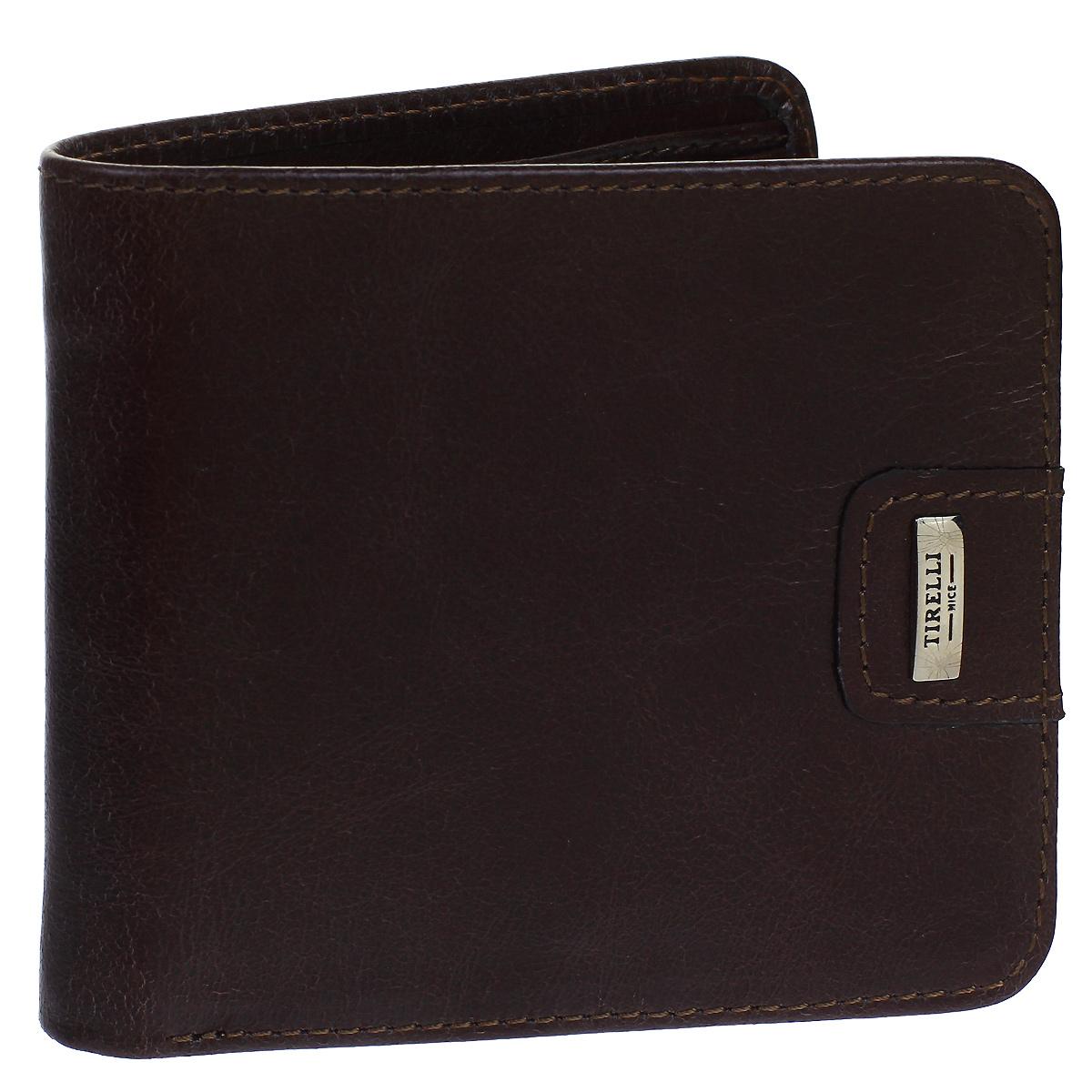 Портмоне мужское Tirelli Денвер, цвет: коричневый. 15-315-1215-315-12Мужское портмоне Tirelli Денвер изготовлено из натуральной кожи коричневого цвета с матовой текстурой. Портмоне оформлено фирменным логотипом. Внутри имеется два отделения для купюр, три кармана для хранения пластиковых карт, визиток, дисконтных карт, одно отделение с пластиковым окошком для фото и один потайной кармашек. Такое портмоне не только поможет сохранить внешний вид ваших документов и защитит их от повреждений, но и станет ярким аксессуаром, который подчеркнет ваш образ. Изделие упаковано в подарочную коробку синего цвета с логотипом фирмы Tirelli. Характеристики: Материал: натуральная кожа, текстиль, металл. Цвет: коричневый. Размер портмоне (в сложенном виде): 11 см х 9,5 см х 1,5 см.