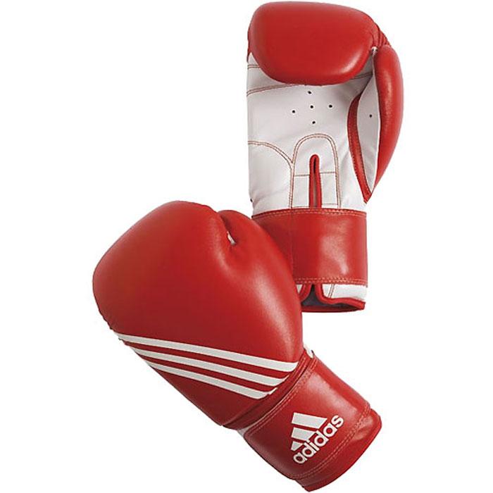 Перчатки боксерские Adidas Training, цвет: красно-белый. adiBT02. Вес 8 унцийadiBT02Боксерские перчатки Adidas Training изготовлены из мягкого полиуретана PU3G, который по своим качествам не уступает натуральной коже. Внутренний наполнитель из многослойной пены закрывает тыльную сторону и боковую часть ладони, обеспечивая надежную защиту рук боксера и позволяя безопасно тренироваться в полную силу. Предварительно изогнутый по технологии Intelligent Mould Technology крой перчатки позволяет боксеру держать кулак в правильном положении. Загнутый параллельно кулаку большой палец обеспечивает безопасность при нанесении ударов и защищает большой палец от вывихов и травм. Внутренняя подкладка и вентиляционные отверстия на ладони создают максимальный уровень комфорта для рук, поддерживая оптимальный микроклимат внутри перчаток. Широкий ремень, охватывая запястье, полностью оборачивается вокруг манжеты, благодаря чему создается дополнительная защита лучезапястного сустава от травмирования. Застежка на липучке способствует быстрому и удобному одеванию перчаток, плотно...