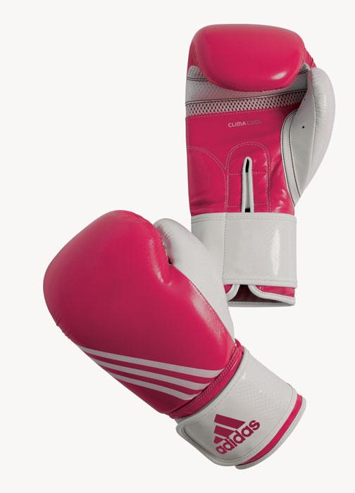 Перчатки боксерские Adidas Fitness, цвет: розово-белый. adiBL05. Вес 10 унцийadiBL05Боксерские перчатки Adidas Fitness изготовлены из искусственной кожи с отделкой внутренней области пальцев. Тренировочная модель. Гелиевая набивка. Фиксация манжеты с помощью эластичной застежки велкро. Система ClimaCool - микровентиляция, способствует полному удалению внутренней влаги.