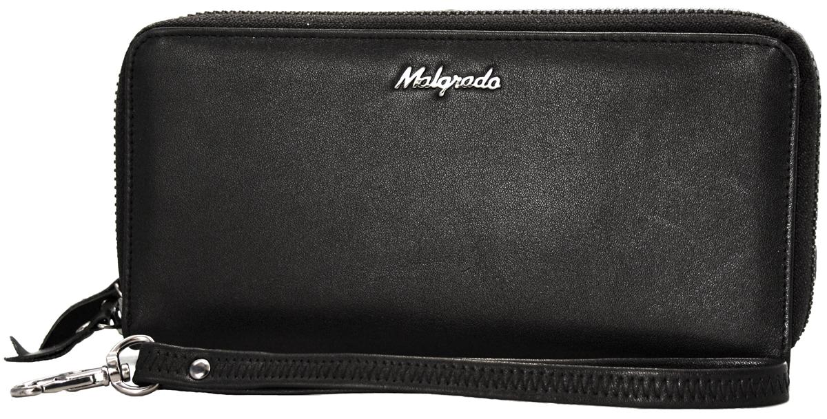 Кошелек Malgrado, цвет: черный. 73007-55D73007-55D BlackКошелек Malgrado изготовлен из натуральной кожи черного цвета. Изделие имеет два основных отделения, которые закрываются на застежки-молнии. Внутри отделения для визиток находится два потайных кармашка, прозрачное окошко для фотографии и 8 кармашков для пластиковых карт и визиток. Внутри второго отделения расположено два отдела для купюр, разделенных средником на молнии для мелочи, а также два потайных кармашка. В комплекте - отстегивающийся ремешок для запястья на замке-карабине. Такой кошелек - это невероятно функциональный аксессуар. Его можно использовать в качестве визитницы, а также вечерней сумочки. Он стильно дополнит ваш образ и станет незаменимым предметом вашего гардероба. Кошелек упакован в подарочную металлическую коробку синего цвета.