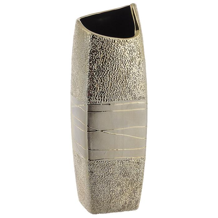 Ваза для цветов Кения, высота 40 смSDJ-2-602131-2-ALЭлегантная ваза Кения послужит отличным дополнением к интерьеру вашего дома. Ваза изготовлена из керамики и украшена золотистыми узорами. Необычная форма и золотистый цвет вазы будут прекрасно сочетаться с ярким букетом. Эксклюзивная ваза подчеркнет оригинальность интерьера и прекрасный вкус хозяина. Создайте в своем доме атмосферу уюта, преображая интерьер стильными, радующими глаза предметами. Также ваза может стать хорошим подарком вашим друзьям и близким. Характеристики: Материал: керамика. Высота вазы: 40 см. Диаметр отверстия для цветов: 11 см. Производитель: Китай.