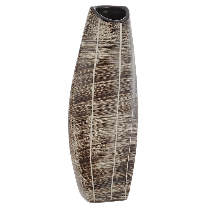 Ваза для цветов Конго, высота 29,5 смSDJ-602730-1-ALЭлегантная ваза Конго, выполненная из керамики, послужит отличным дополнением к интерьеру вашего дома. Необычная форма и бежево-коричневый цвет вазы будут прекрасно сочетаться с ярким высоким букетом. Эксклюзивная ваза подчеркнет оригинальность интерьера и прекрасный вкус хозяина. Создайте в своем доме атмосферу уюта, преображая интерьер стильными, радующими глаза предметами. Также ваза может стать хорошим подарком вашим друзьям и близким.