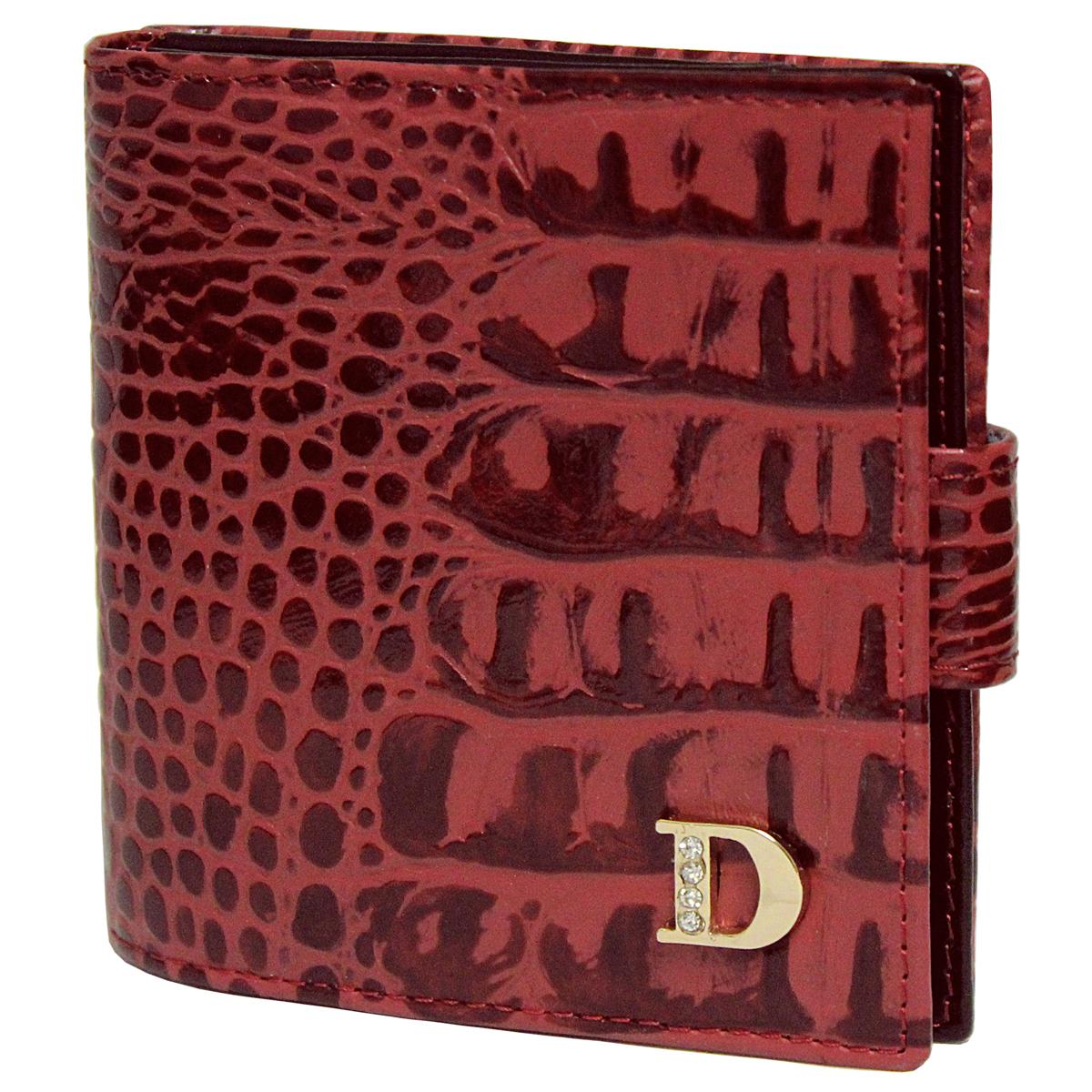 Кошелек женский Dimanche Loricata Rouge, цвет: красный, черный. 210210Женский компактный кошелек Loricata Rouge выполнен из натуральной высококачественной кожи с декоративным тиснением. Кошелек состоит из двух отделений. Первое отделение закрывается на магнитную кнопку, имеет четыре кармашка для кредиток и карман для монет с клапаном на кнопке. Второе отделение также закрывается на магнитную кнопку и содержит два кармана для купюр. Между отделениями также предусмотрен кармашек. Кошелек упакован в фирменную картонную коробку.