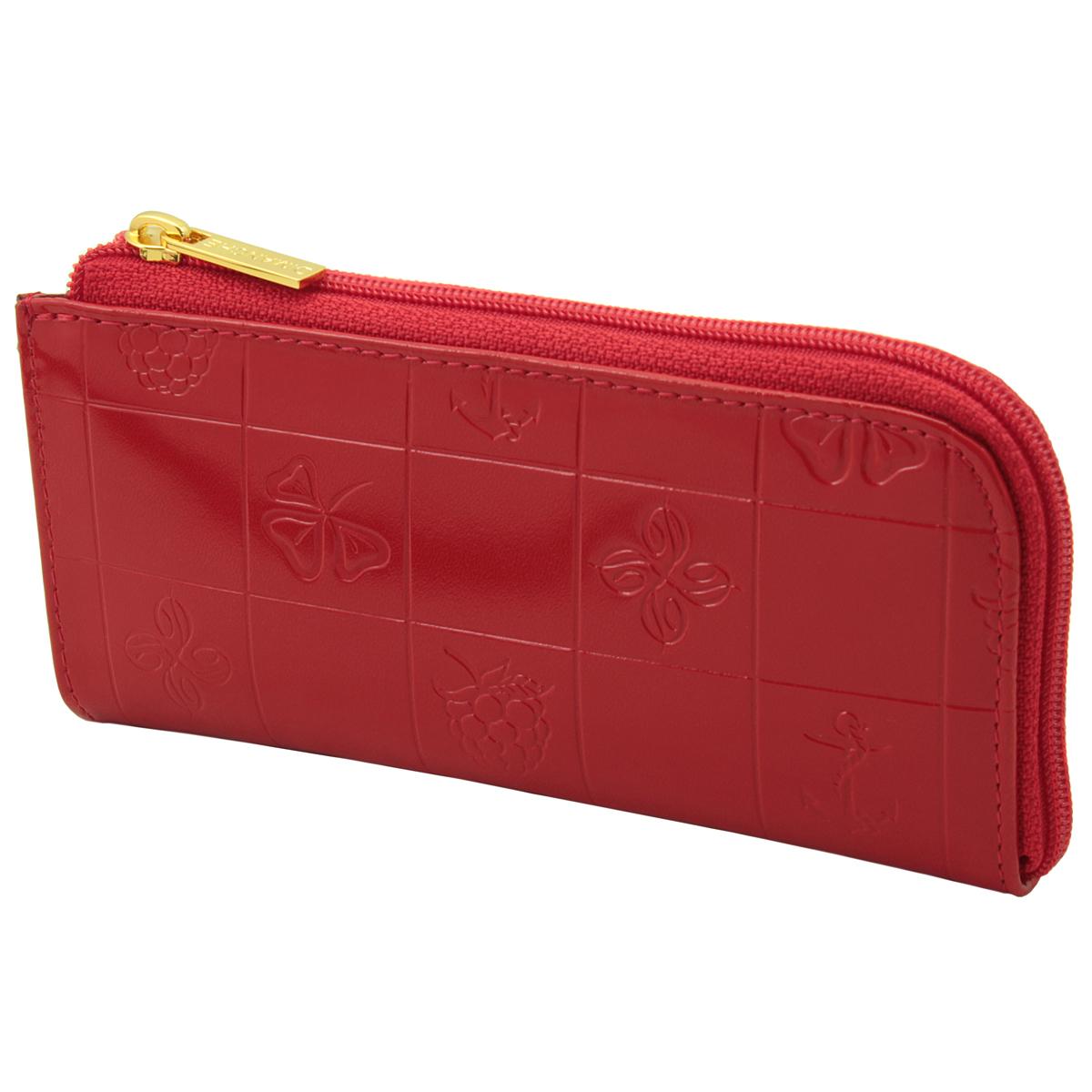 Ключница Dimanche Bonbon, цвет: красный. 219219Компактная ключница Bonbon - стильная вещь для хранения ключей. Ключница выполнена из натуральной кожи красного цвета с тиснением. Состоит из одного отделения, закрывающегося на застежку-молнию. Внутри ключницы на кожаной петле крепится металлическое кольцо для ключей. На внешней стороне расположен дополнительный карман на молнии. Ключница упакована в фирменную картонную коробку.