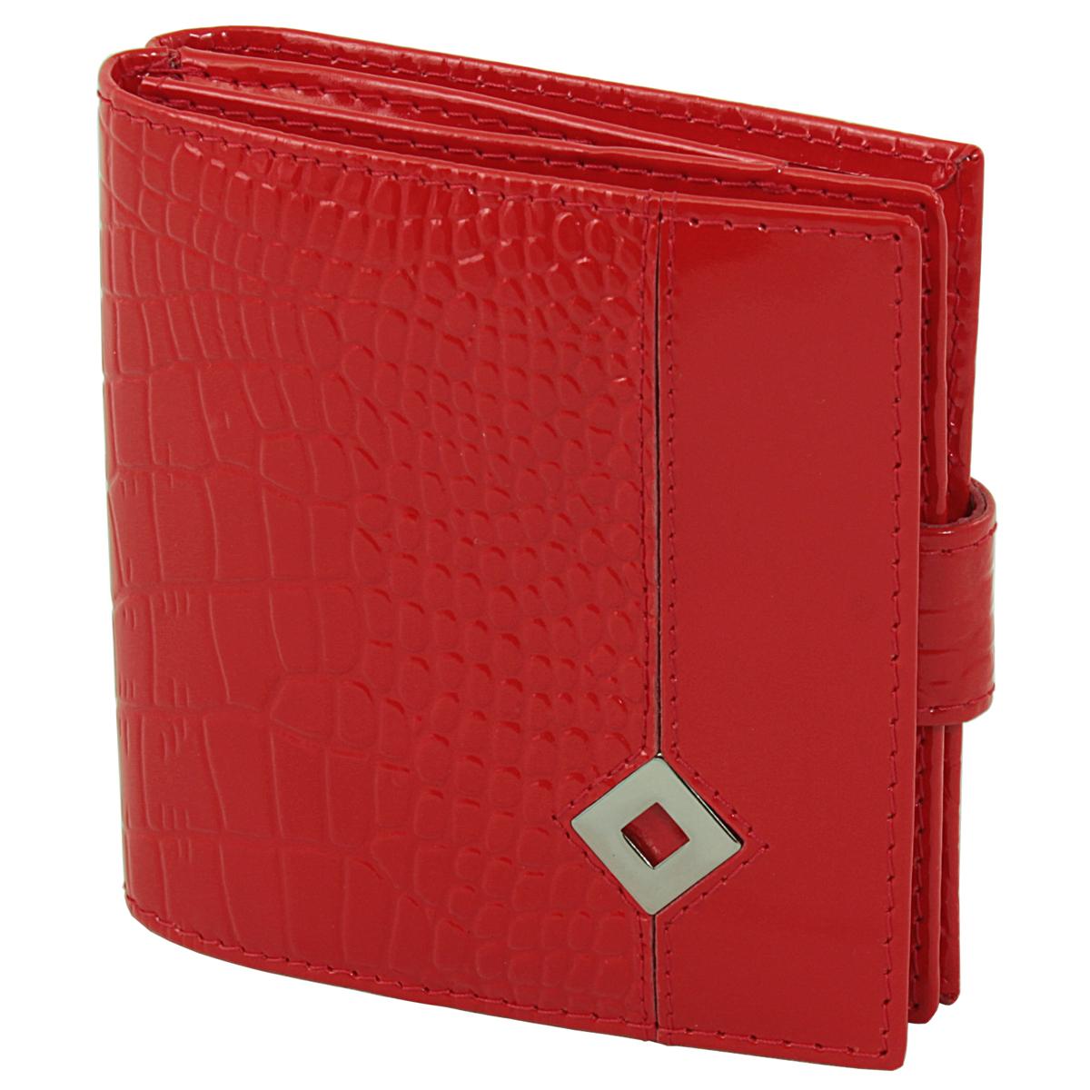 Кошелек женский Dimanche Papillon Rouge, цвет: красный. 245245Женский компактный кошелек Papillon Rouge выполнен из натуральной высококачественной кожи с декоративным тиснением. Кошелек состоит из двух отделений. Первое отделение закрывается на магнитную кнопку, имеет четыре кармашка для кредиток и карман для монет с клапаном на кнопке. Второе отделение также закрывается на магнитную кнопку и содержит два кармана для купюр. Между отделениями также предусмотрен кармашек. Кошелек упакован в фирменную картонную коробку.