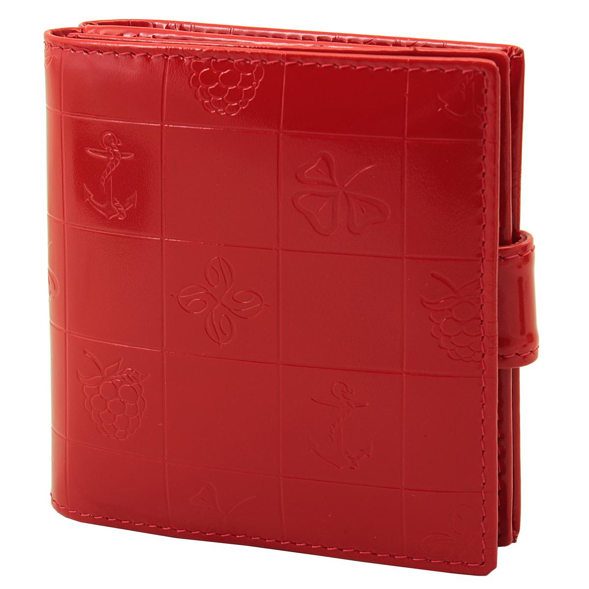 Кошелек женский Dimanche BonBon, цвет: красный. 248248Женский компактный кошелек BonBon выполнен из натуральной высококачественной кожи с декоративным тиснением. Кошелек состоит из двух отделений. Первое отделение закрывается на магнитную кнопку, имеет четыре кармашка для кредиток и карман для монет с клапаном на кнопке. Второе отделение также закрывается на магнитную кнопку и содержит два кармана для купюр. Между отделениями также предусмотрен кармашек. Кошелек упакован в фирменную картонную коробку.